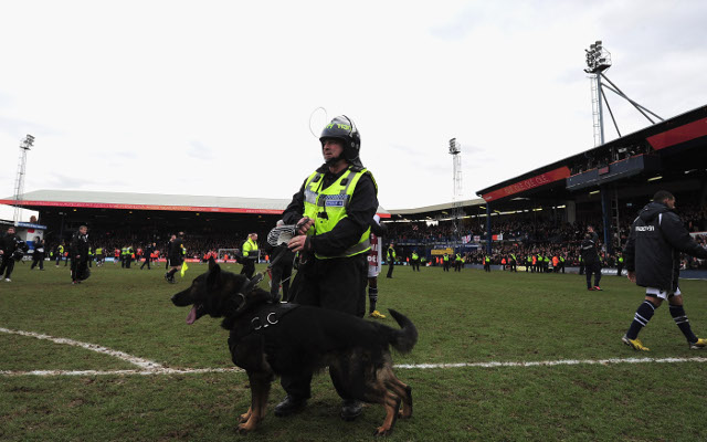 Police dressed in riot gear a reminder football cannot forget its past