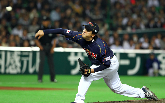 Japan edge Holland to finish top of pool in World Baseball Classic
