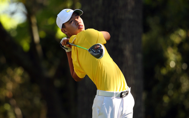 Guan Tianlang battles on despite tough conditions at Augusta