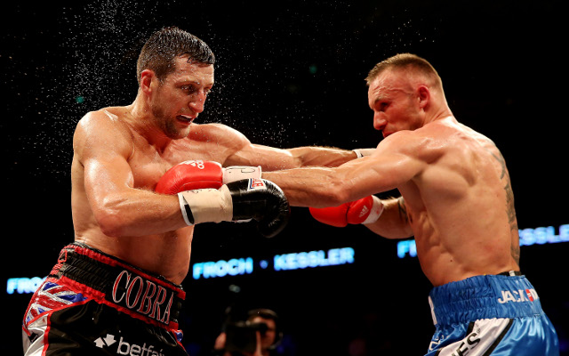 Carl Froch defeats Mikkel Kessler by unanimous decision for WBA and IBF belts