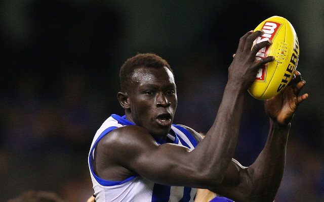 North Melbourne AFL player Majak Daw charged with rape