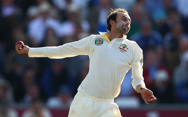 "Muttiah Muralitharan helping Nathan Lyon to perfect the ""carrom"" delivery"