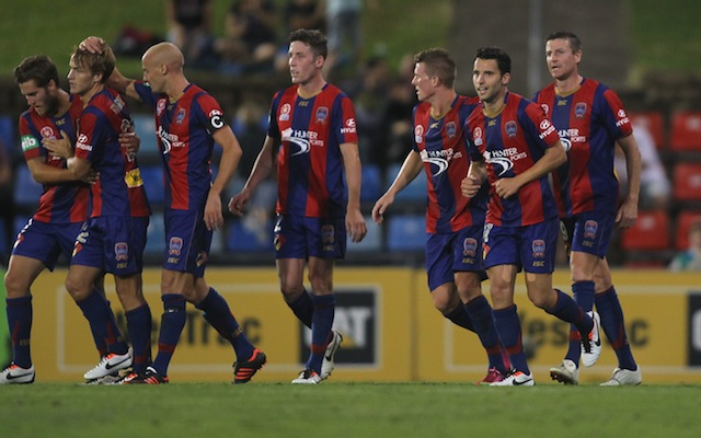 (Image) Newcastle Jets players engage their spiritual core with Yoga session