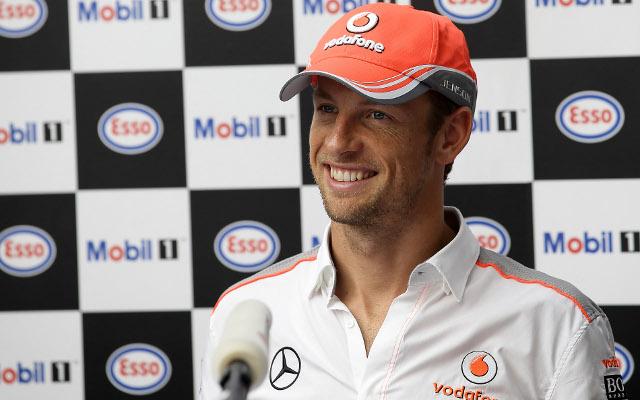 McLaren driver Jenson Button stars in F1 car-wash stunt