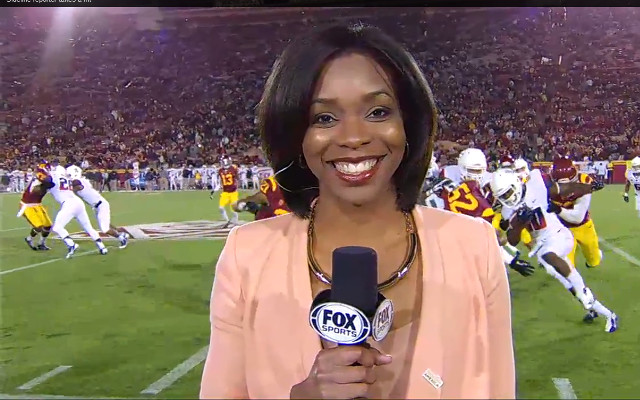 (Video) Sideline college football reporter gets taken out by players