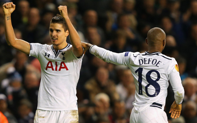 (Image) Miserable Tottenham star Erik Lamela poses for photo with delighted Arsenal fan