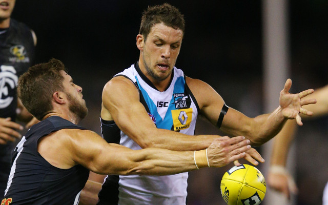 Travis Boak injures his ankle in Port Adelaide's win over Melbourne Demons