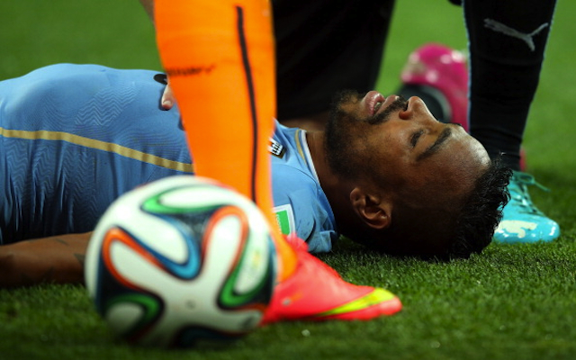 (Video) Uruguay defender Alvaro Pereira refuses to be subbed after being knocked unconscious by Raheem Sterling