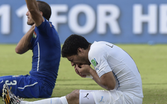 (Gif) The moment Liverpool's Luis Suarez bit Giorgio Chiellini at the 2014 World Cup