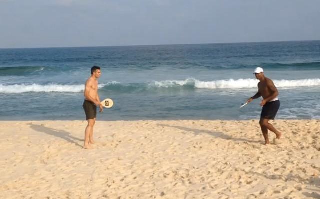 (Video) Man United star Robin van Persie plays extreme beach tennis with Patrick Kluivert