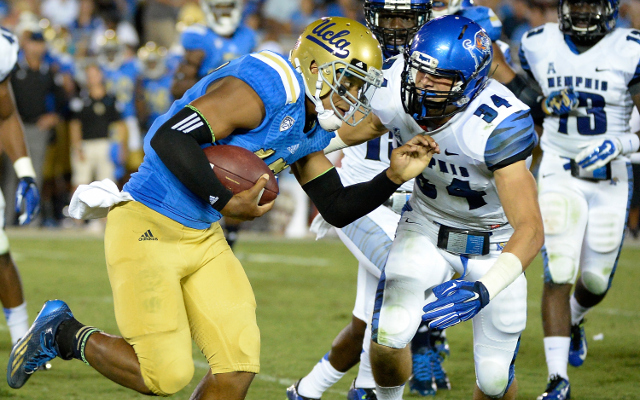 #11 UCLA avoids upset and defeats Memphis, 42-35