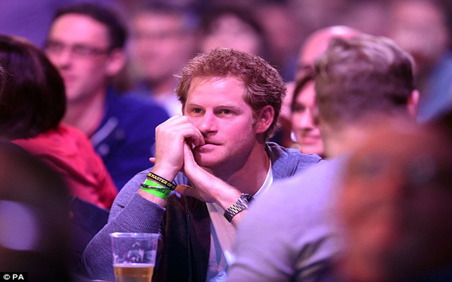 (Images) Prince Harry watches intently as darts stars impress at the Alexandra Palace