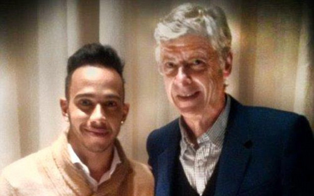 Formula One champion Lewis Hamilton rubs elbows with Arsenal boss Arsene Wenger