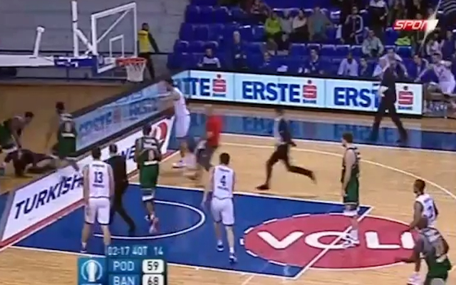(Video) BRUTAL! Watch as a basketballer clotheslines a fan in a Eurocup clash in Turkey