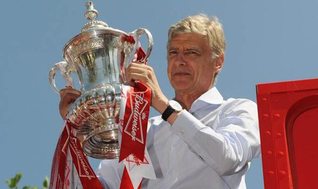 Arsenal boss Arsene Wenger admits he loves the FA Cup a bit TOO much