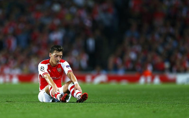 Mesut Ozil claims his knee injury is down to working too hard