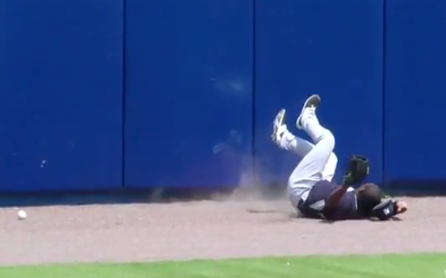 (Video) WHACK! New York Yankees fielder Jose Pirela CONCUSSED after slamming into outfield wall!