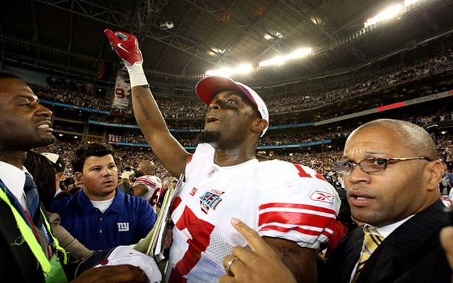 Former Super Bowl hero Plaxico Burress avoids jail for tax evasion