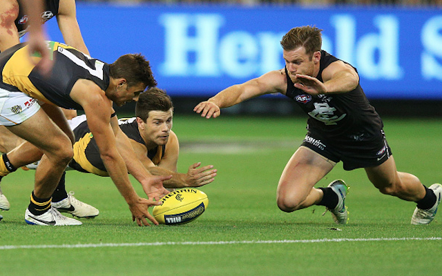 AFL news: Carlton lock-in star defender for three seasons