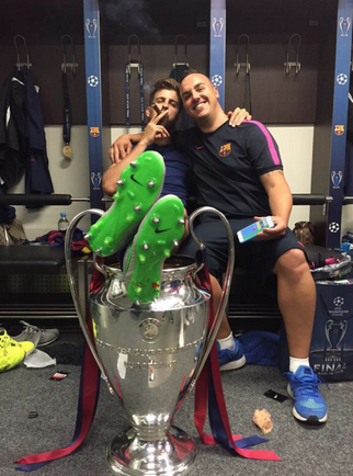 Pique smoking with Champions League trophy